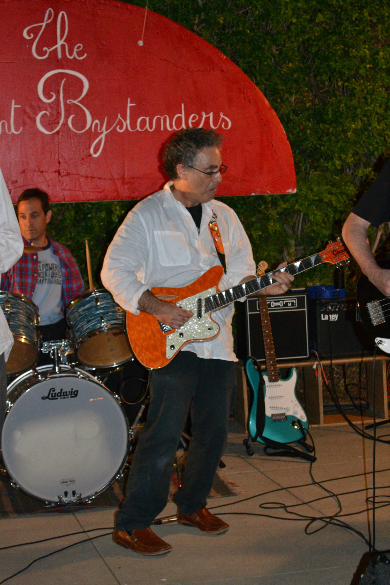 The Innocent Bystanders perform live music at a house party in Kensington.