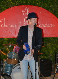 Jeff Slattery plays live music at a backyard party in San Diego.