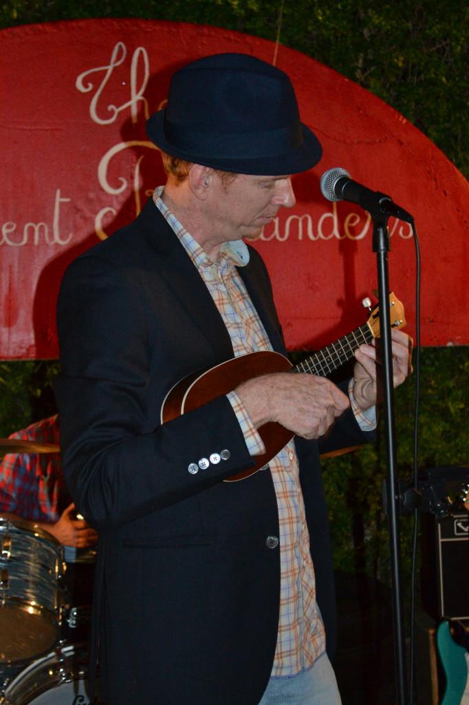 Innocent Bystander Jeff Slattery plays ukulele at a backyard party in Kensington, San Diego.